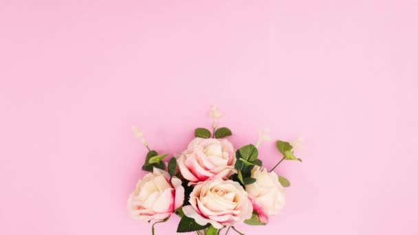 Womens day decoration with ribbon and roses appear on pink theme. Stop motion