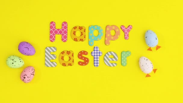 Frohe Ostern Stop-Motion-Animation auf gelbem Thema. Stop-Motion