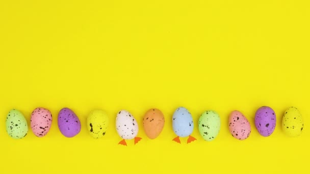 Creative Easter eggs with legs move from bottom to middle of yellow theme. Stop motion