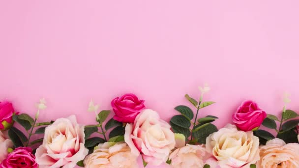 Floral bloom arrangement move with roses and eucalyptus move on pastel pink background. Stop motion