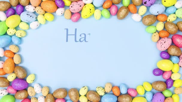 Happy Easter write in frame on pastel blue background with vibrant eggs. Stop motion