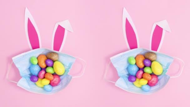 Zwei kreative Ostergesichtsmasken mit Eiern und Hasenohren. Stop-Motion