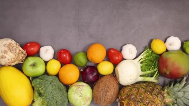 Organic healthy fruits and vegetables move ordered on the bottom of kitchen table. Stop motion