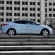 stock-photo-blue-korean-car-on-the
