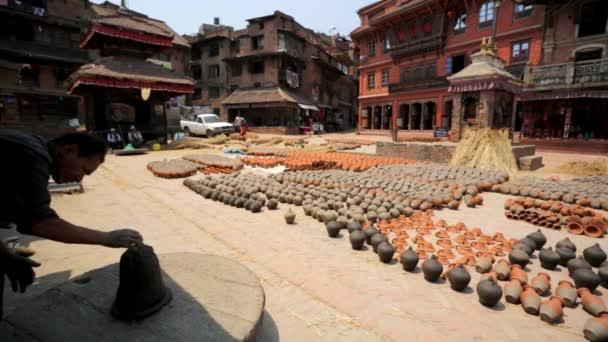 Nepalese men making pottery
