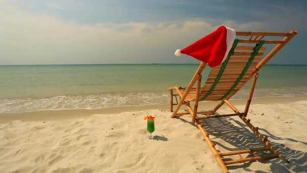 Sunlounger with Santa hat and coctail