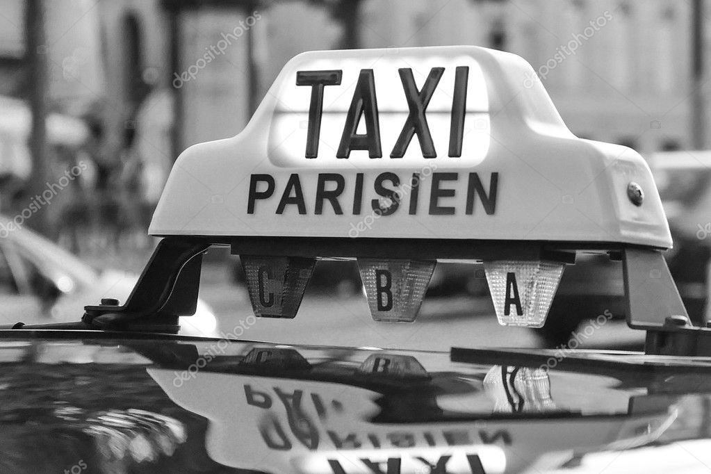 Paris taxi detail and Arc de Triomphe in the background