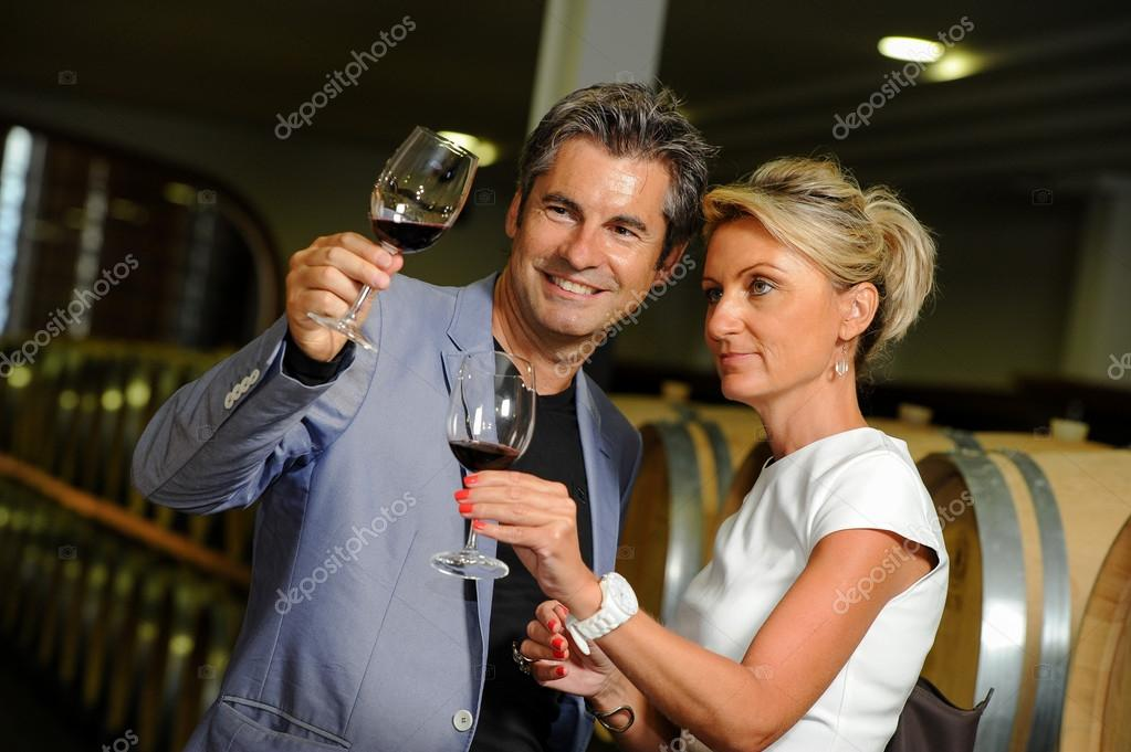 Tourism - Couple tasting wine in a cellar