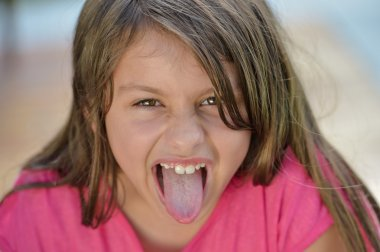 Smiling Young Girl Tongue
