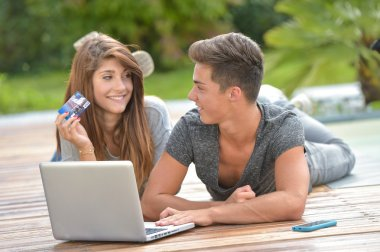 Young couple making purchases on Internet