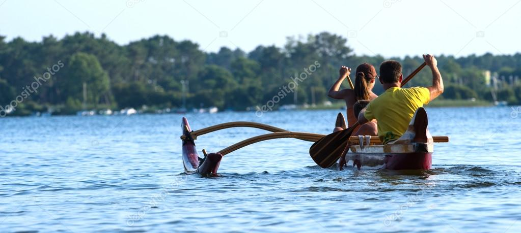Couple making canoe kayak on a lake