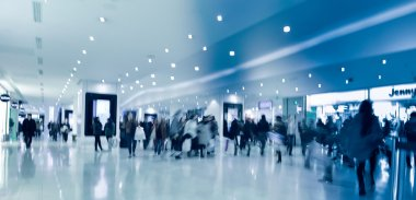 Blurred People in Corridor