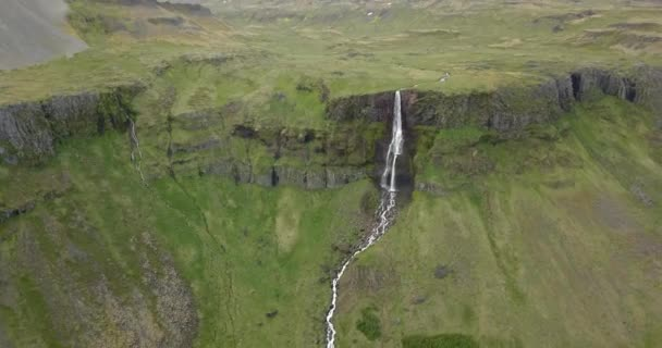 Aerial view of Large waterfall with green landscape in IcelandDrone view over amazing Waterfall in Iceland, February 2021