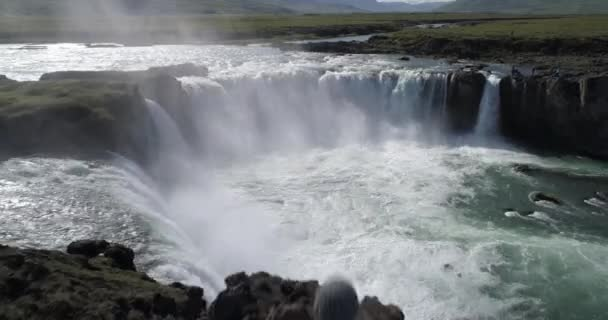 Man standing in front of Godafoss waterfall, aerial,IcelandGodafoss is a waterfall in northern Iceland, Drone view , February 2021