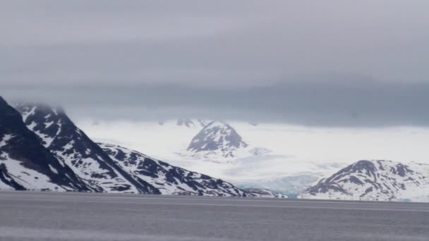 Antarctica snowy mountains and sea