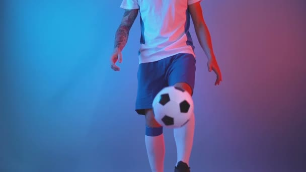 Front view of freestyle soccer or futsal player juggling ball with his legs