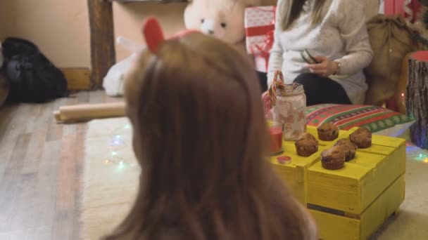 Pregnant woman talking with kid at home during christmas holidays