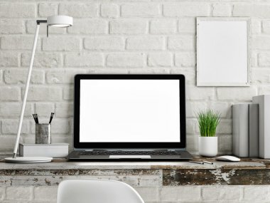 Laptop on wooden table, white brick wall
