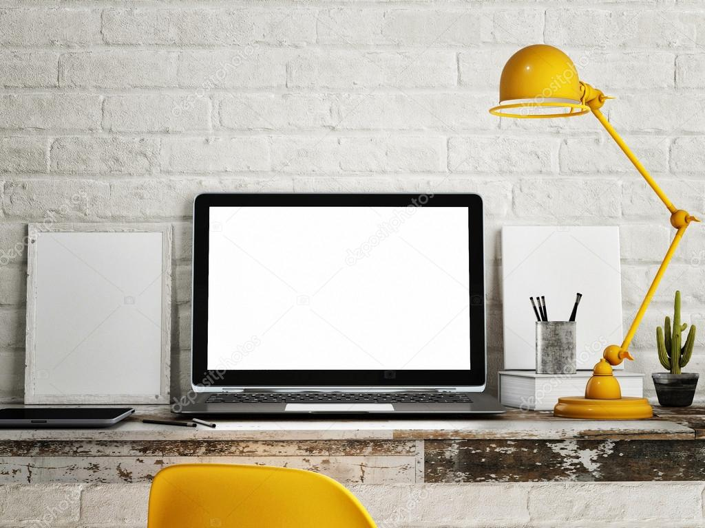 Laptop on table, White brick wall background