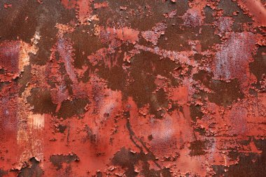 Red, rusty background with peeling paint.