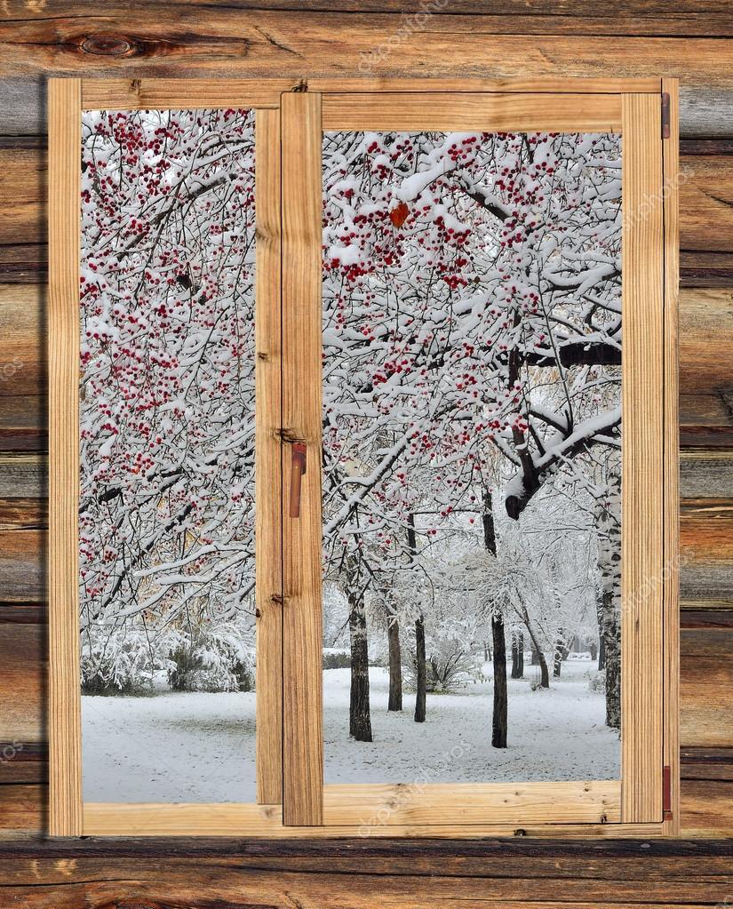 Paysage d 39 hiver enneig dans le cadre d 39 une fen tre en for Fenetre de bois