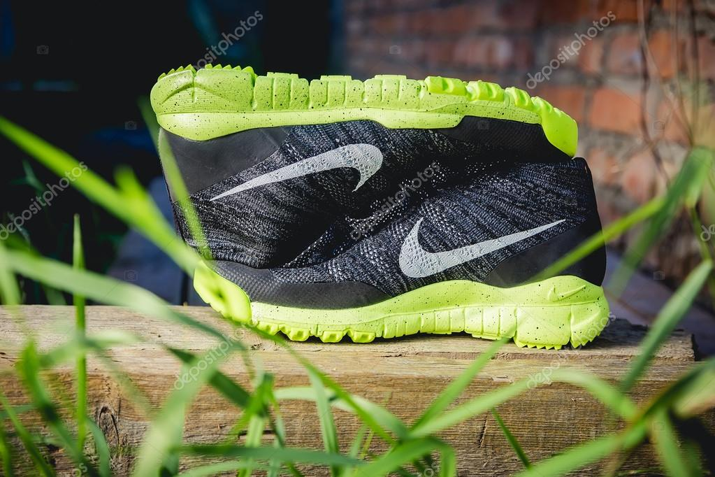 Running shoes in nature, nike, sports shoes — Stock Photo