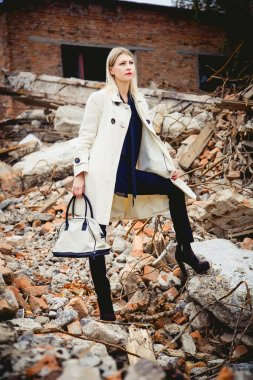 The girl in a white coat, a new collection of women's clothing
