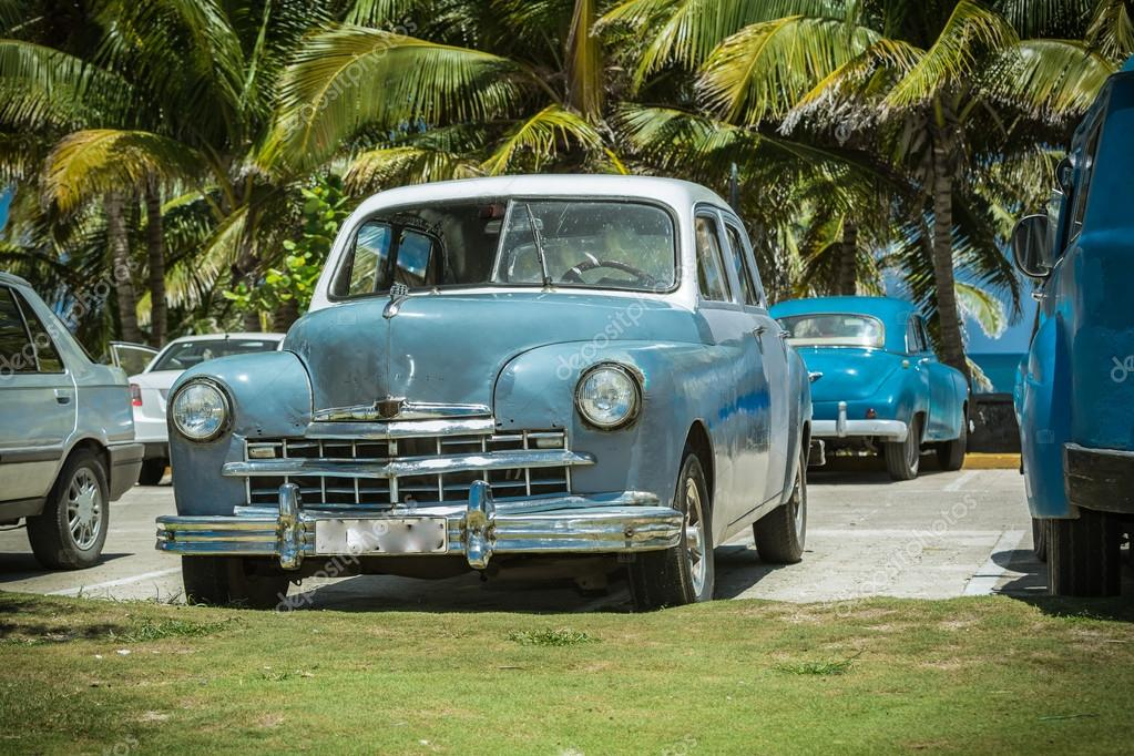 Vintage Retro Classic Cars Parked In Tropical Garden Near The