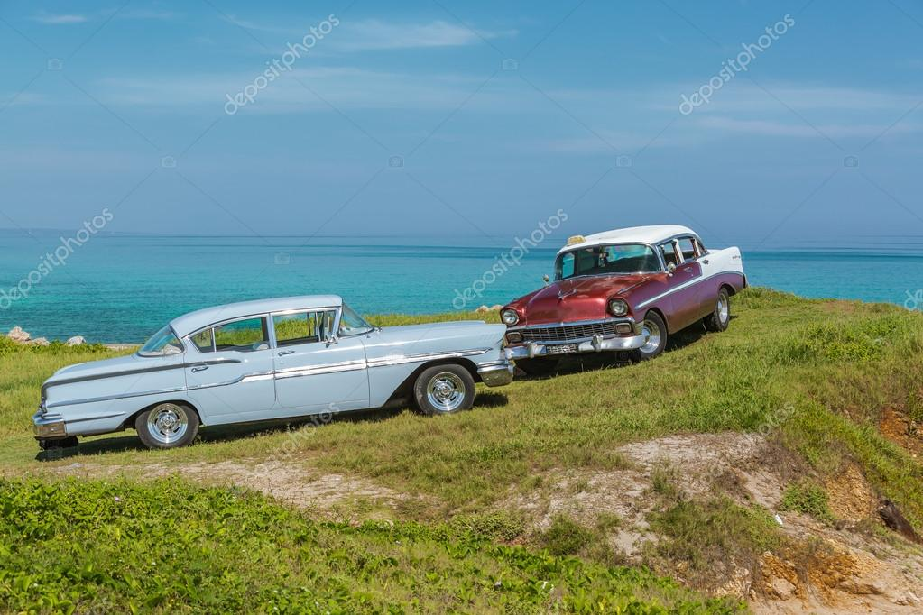 Nice view of old vintage classic retro cars standing above the ocean ...