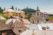 Fotografie View over rooftops of the city Banska Stiavnica