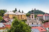 Fotografie Pohled přes střechy města Banské Štiavnice