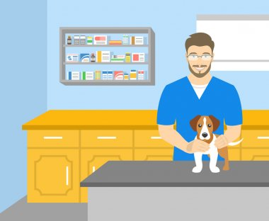 Man veterinarian holding a dog in veterinary office