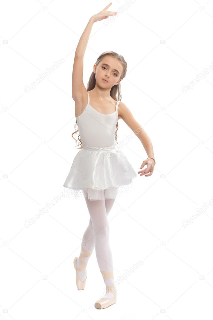 bd8af50e3518 ... dance clothes reaching down to touch her foot. — Stock Photo ·  Beautiful teen girl in white clothes ballet pose with long hair isolated on  white ...