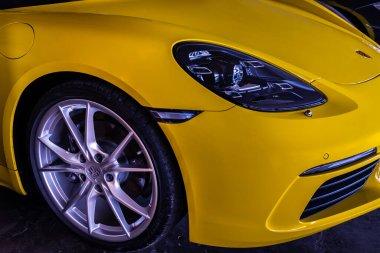 Bangkok, Thailand - 26 Jun 2021 : Close-up of Headlights, Wheel, and Rim of Yellow ferrari sports car. Ferrari is Italian sports car, Selective focus.