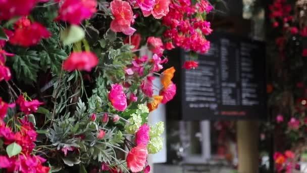 Beautiful Pink Flowers With a Blurry Black Menu as Background
