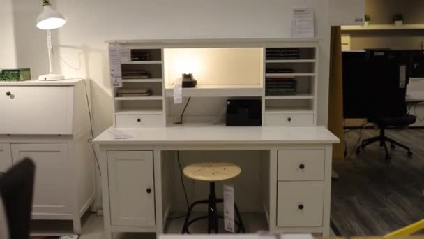 White Desk for Sale Surrounded by More White Furniture in Office Supplies Store