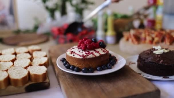Berries and Chocolate Cakes with More Baked Goods on a Table
