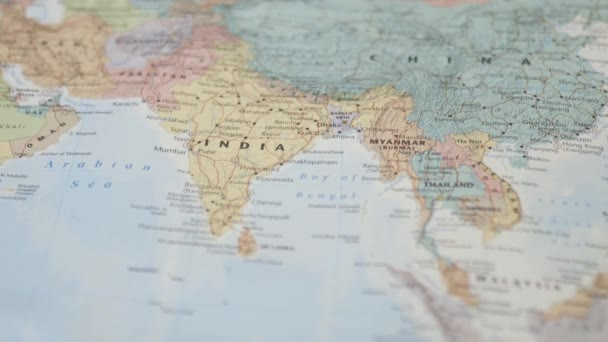 View of South Asia on a Colorful and Blurry World Map