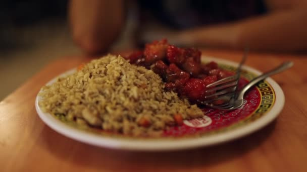 Shot of Chinese Plate with Rice, Sour and Sweet Chicken in Mexican Restaurant