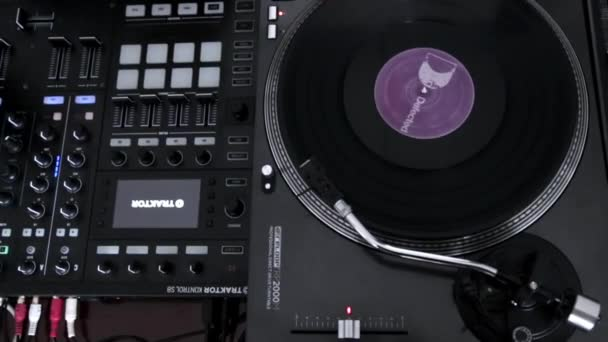 Vinyl record slowly spinning on professional DJ turntable