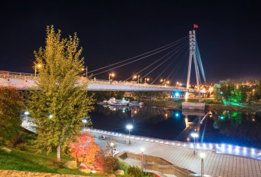 Night view of pedestrian bridge over the Tura river in Tyumen