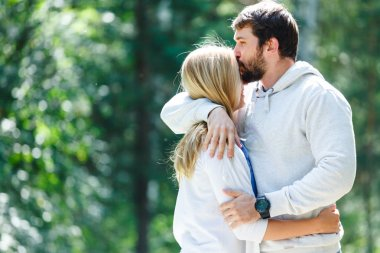 Young couple walks in forest