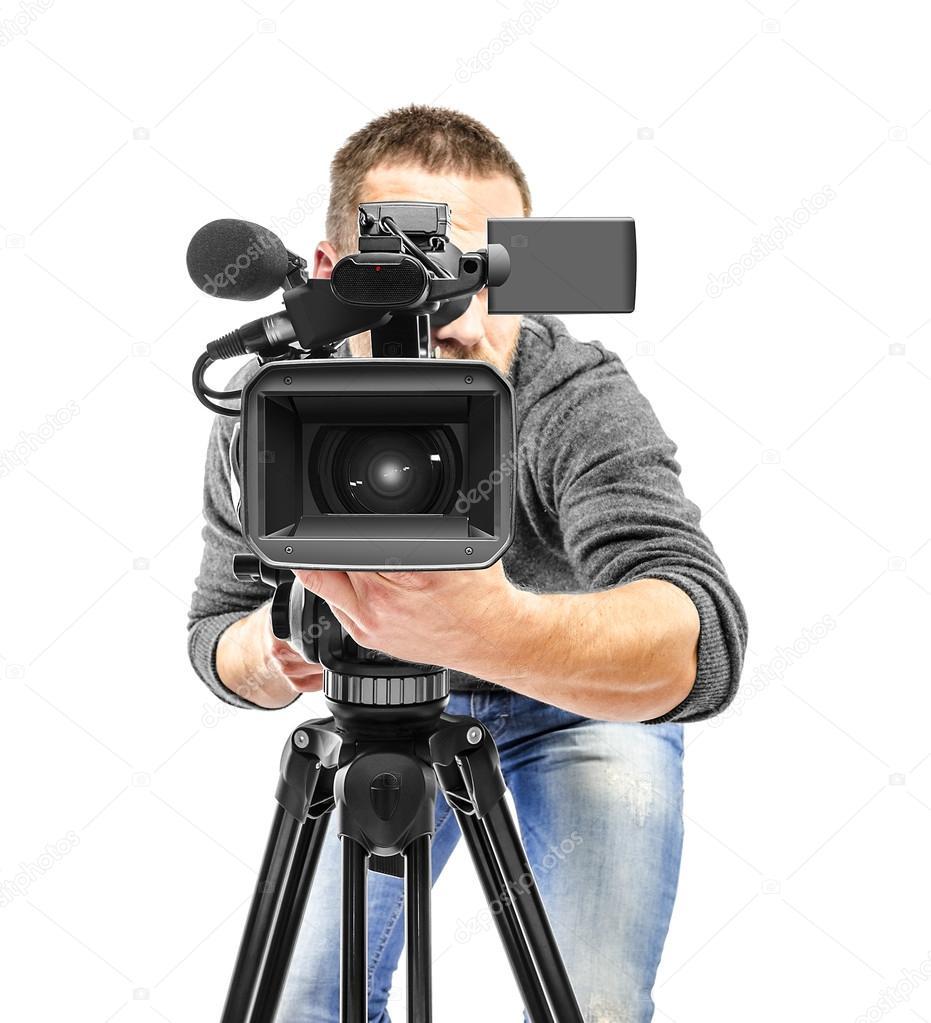 Video camera operator filmed.
