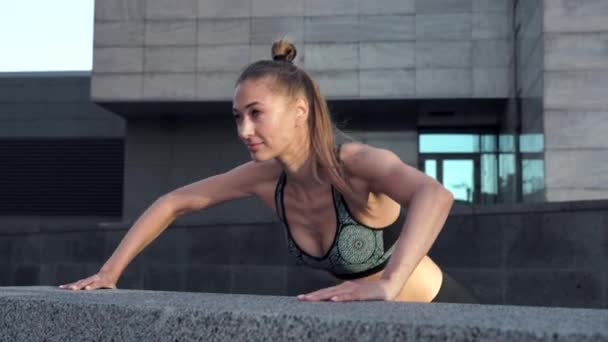 Woman warm up do push up exercises urban city background