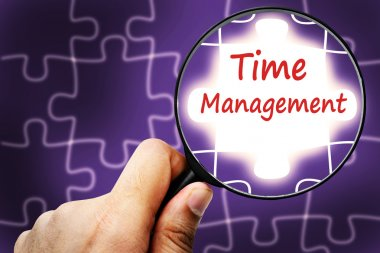 Time management  word. Magnifier and puzzles.