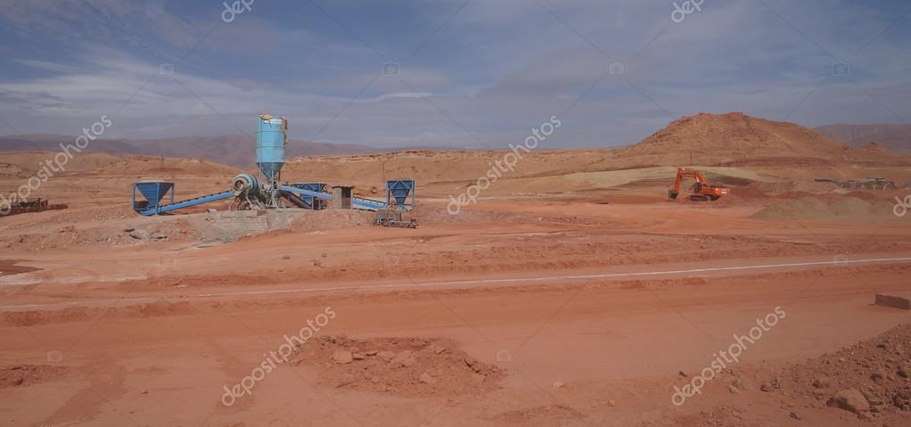 Sahara desert construction site with bulldozer,Morocco