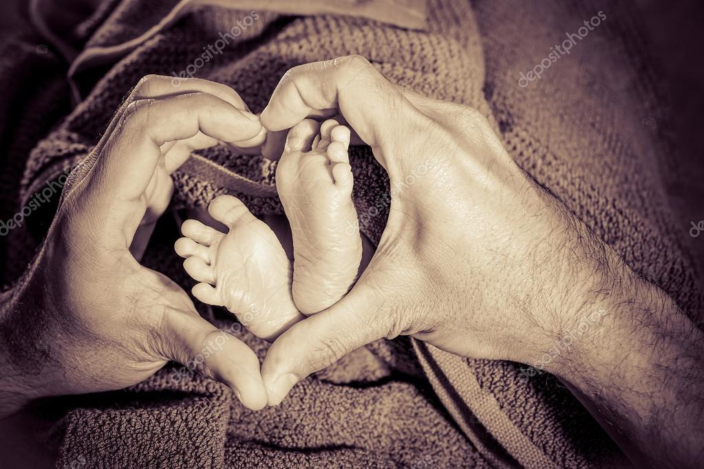 Baby feet in father hands
