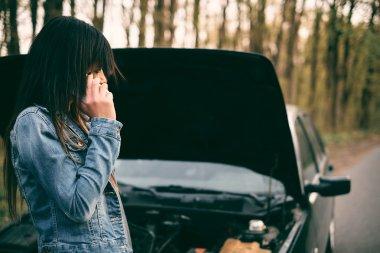 woman with brown hair near the car