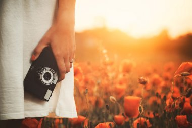 Vintage camera in woman hand
