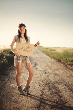 Traveler hippie girl travels hitchhiking